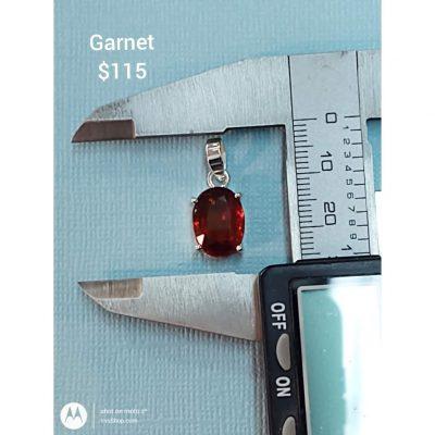 Beautiful reddish orange Garnet in a Silver Pendant.